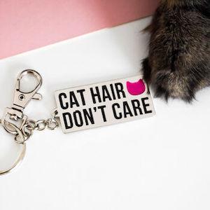 Cat Hair Don't Care Keyring