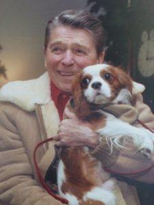 Ronald Reagan and Rex cuddling