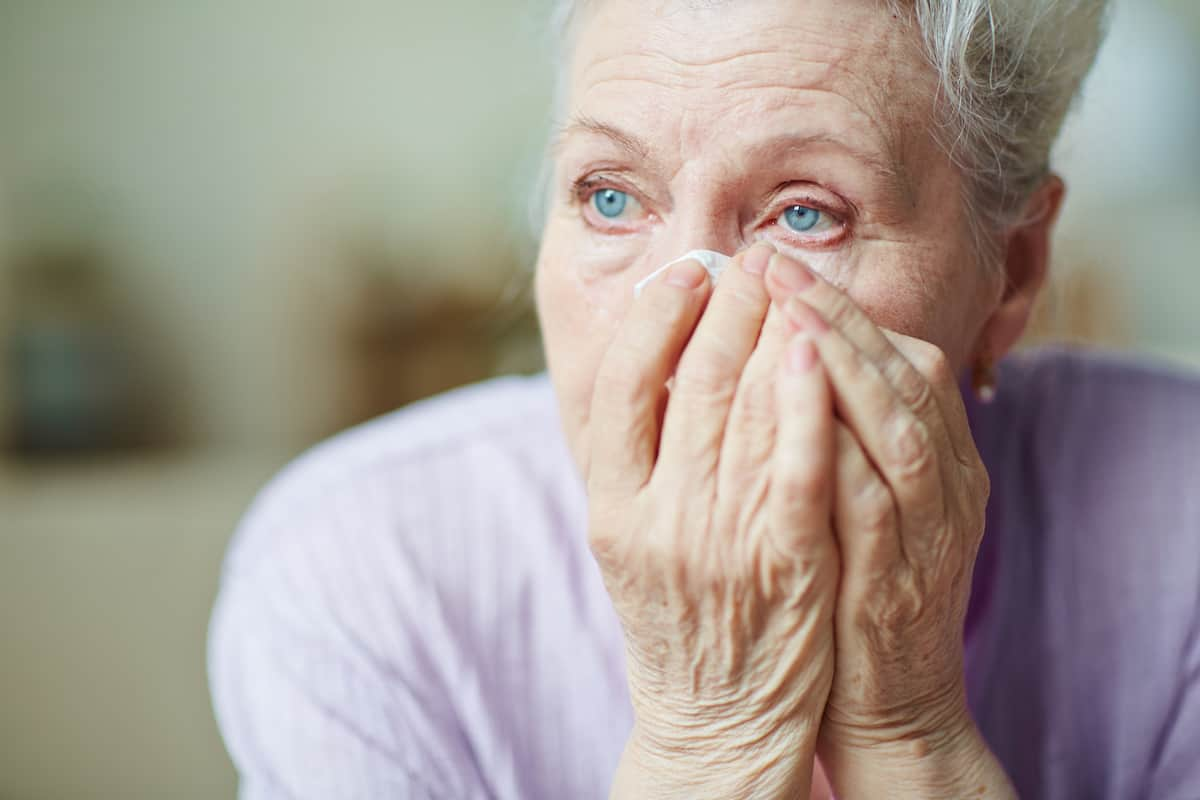 Crying old woman